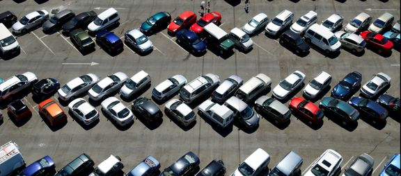 image of cars in a parking lot