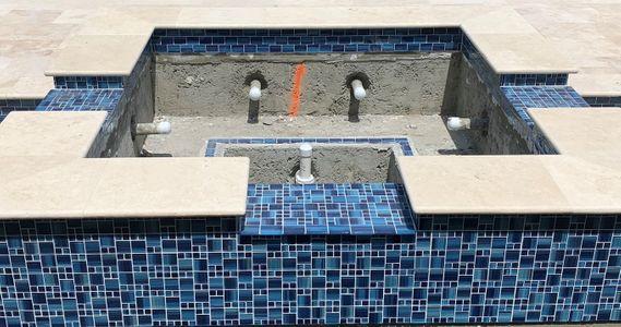 WIP -New Spa being tiled.jpg