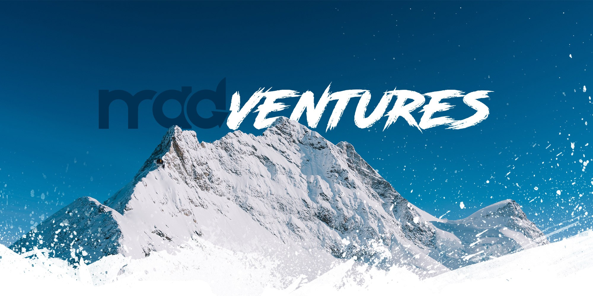 MADventures logo over the mountains