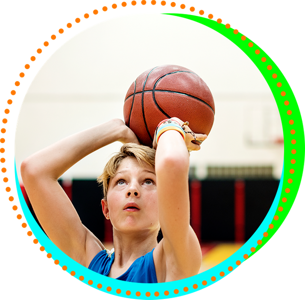 Young boy shooting a basketball.