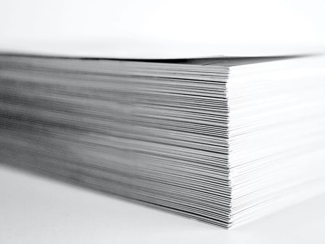 Large stack of white paper