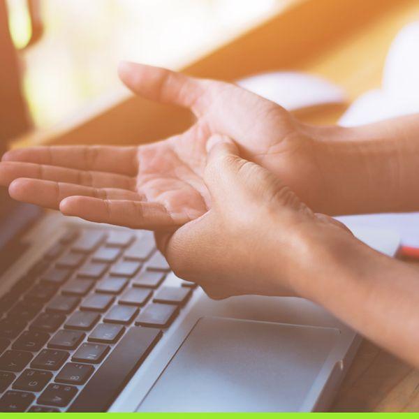 Arthritis in hand over computer