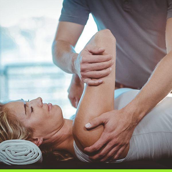 Woman getting her shoulder adjusted