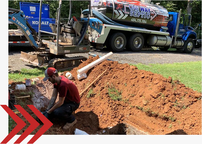 One Way Septic team working on a sewer line.