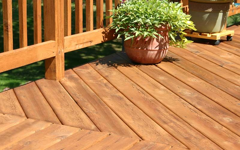 pine colored deck with decorative plants