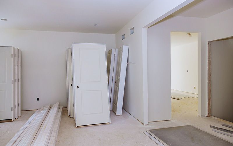new interior doors leaning against the wall during a construction project