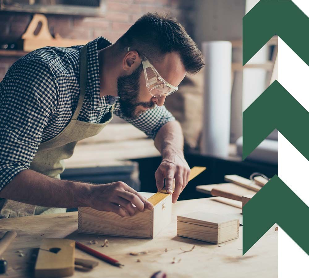 casual woodworker constructing wooden boxes