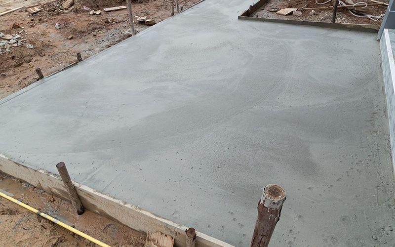 New concrete floor after poured cement at construction site