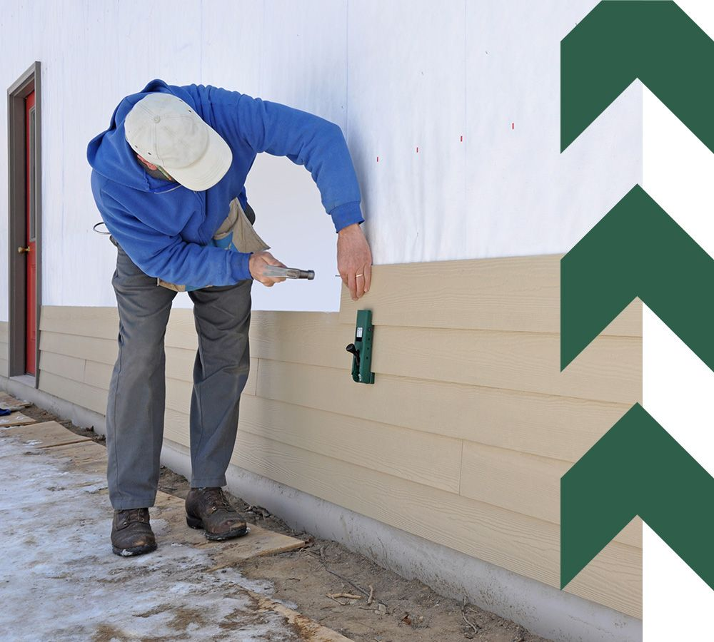 Man installing cement fiber siding using gauges