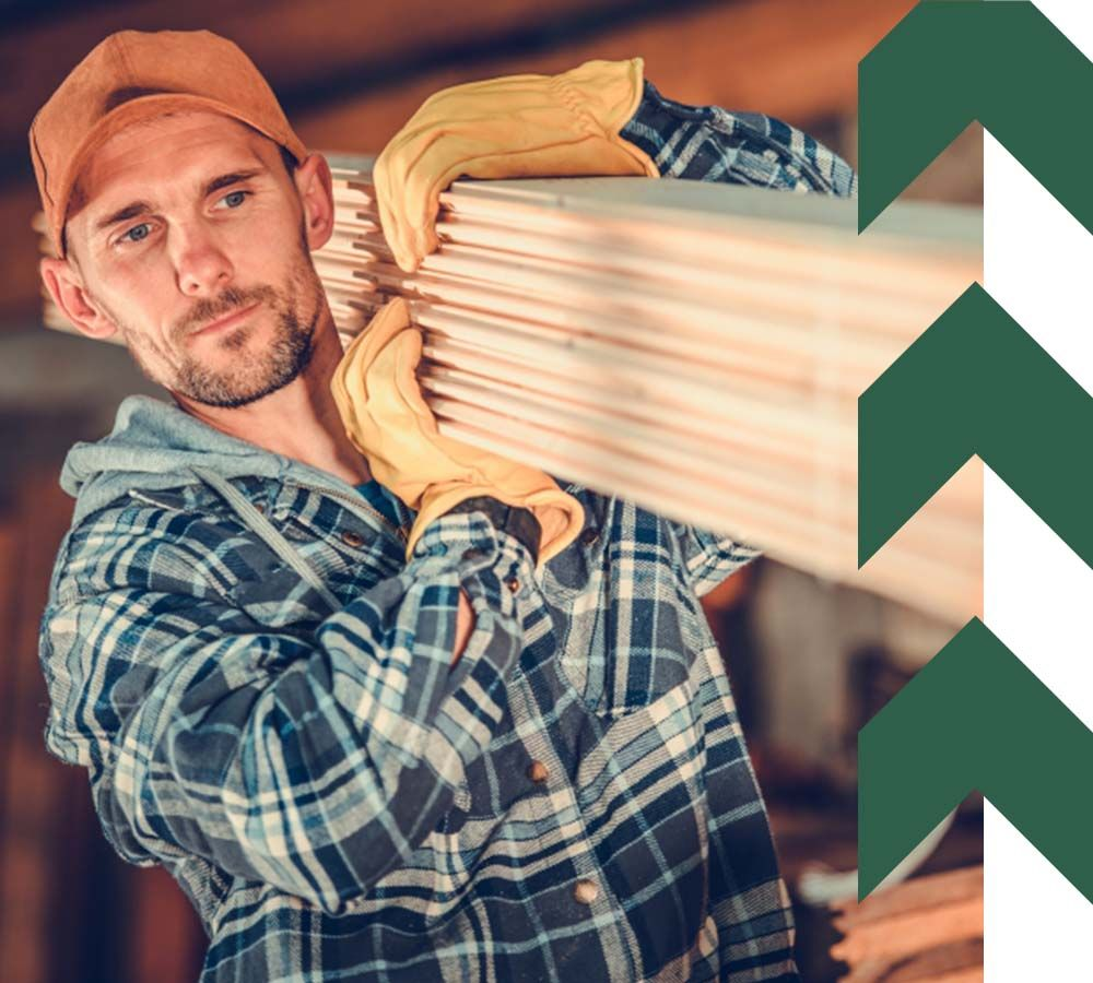 Lumber Contractor with Wooden Planks on His Shoulder.