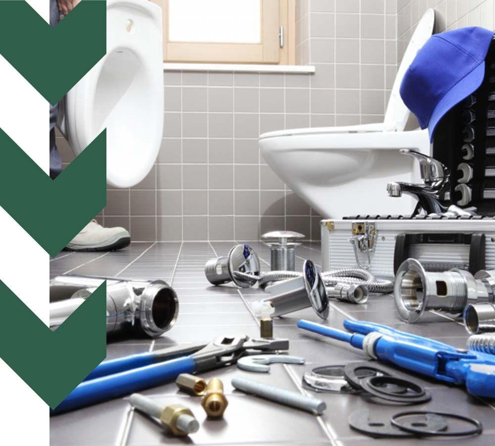 man replacing toilet in clean bathroom