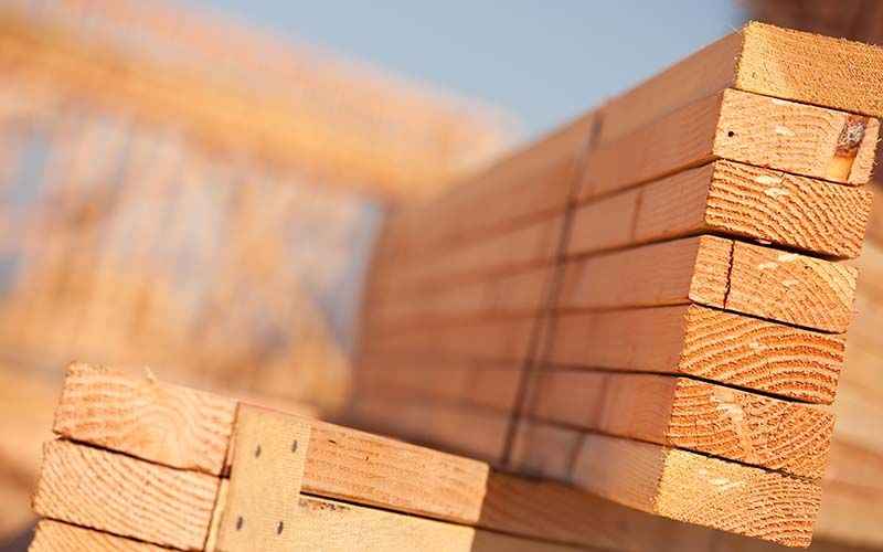 stack of lumber at construction site