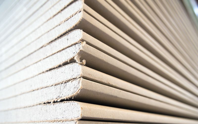 a closeup shot of a stack of sheet rock