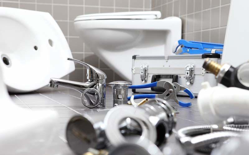 plumbing supplies on bathroom floor