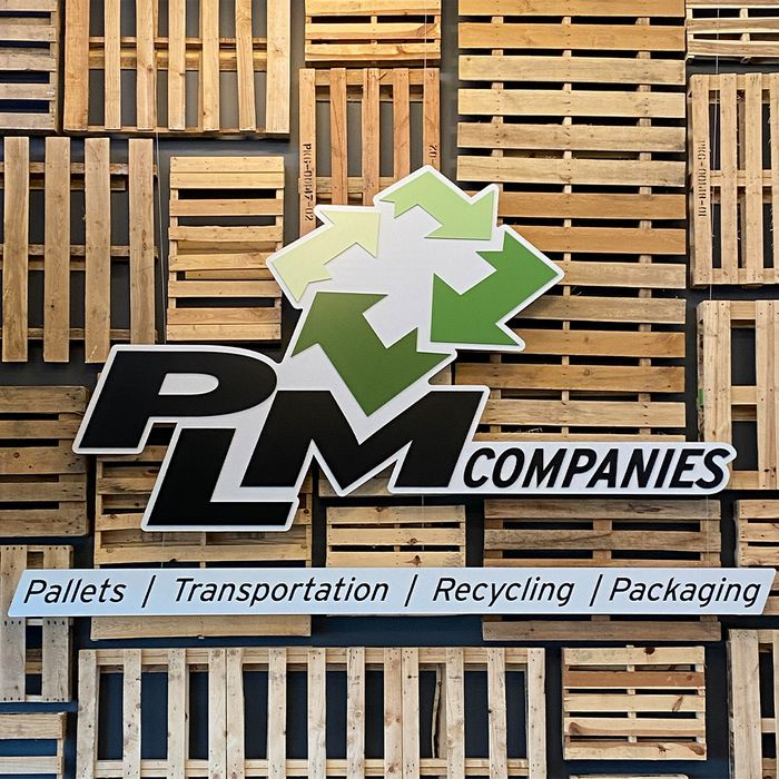 PLM logo with pallets in the background