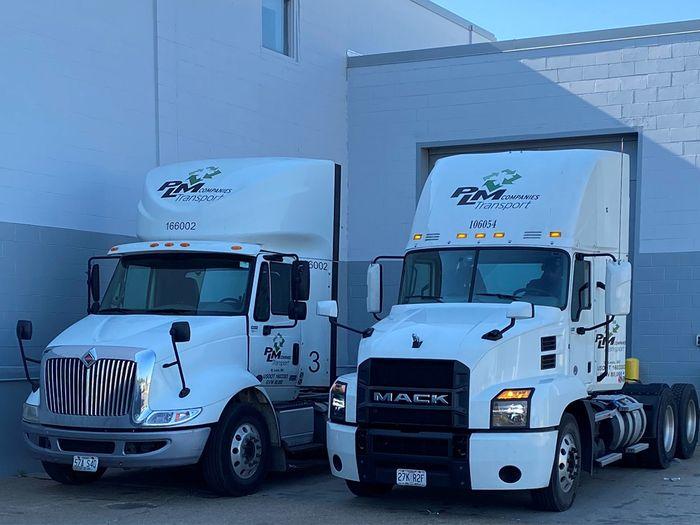 Two PLM Companies fleet trucks.