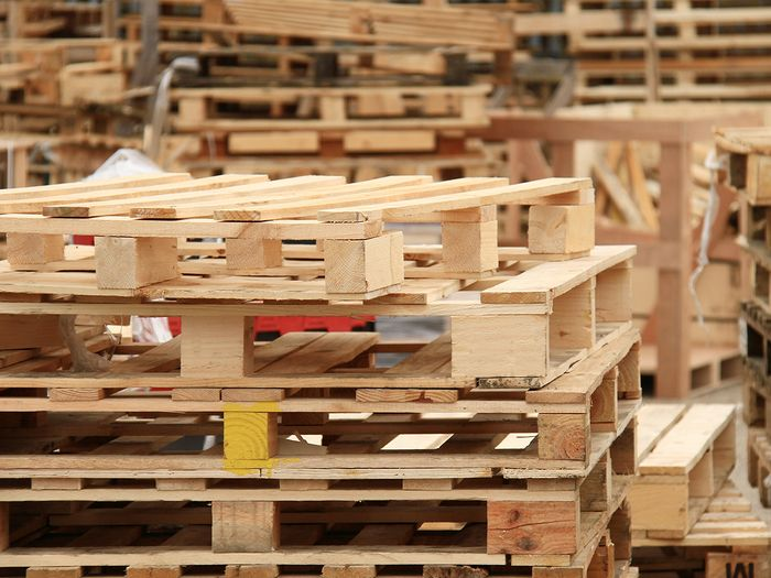 Wooden pallets stacked on top of each other.
