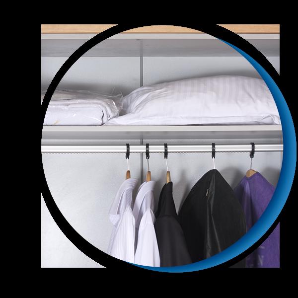 shirts hanging in hotel closet