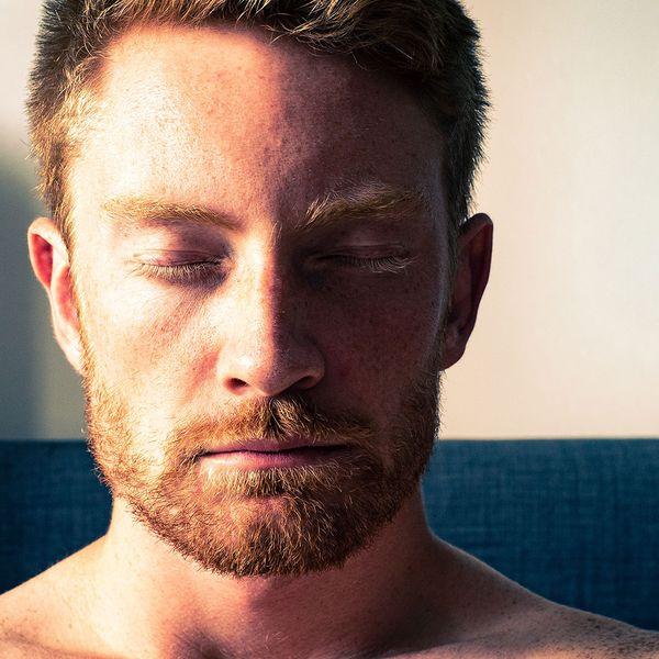Man eyes closed meditating