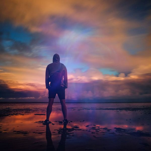 An image of a man staring out at ocean
