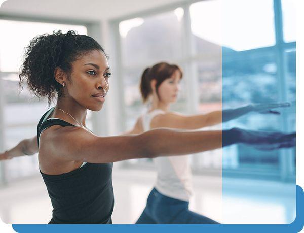 Woman Stretching in Yoga Studio