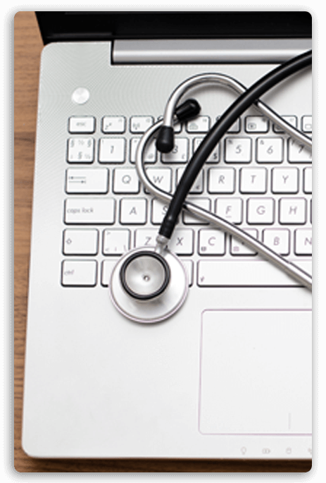 A computer with a stethoscope resting on it