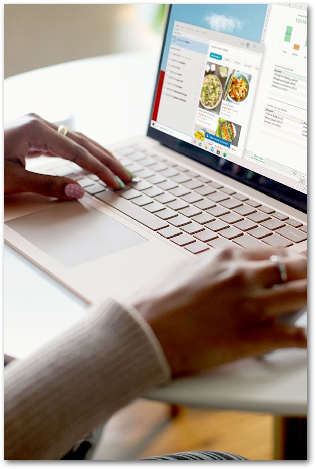 Woman looking at food blog on laptop