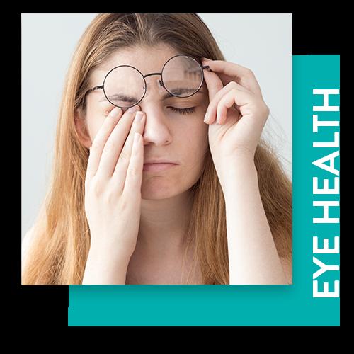 Photo of a woman rubbing her eye