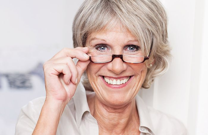Elderly woman with reading glasses