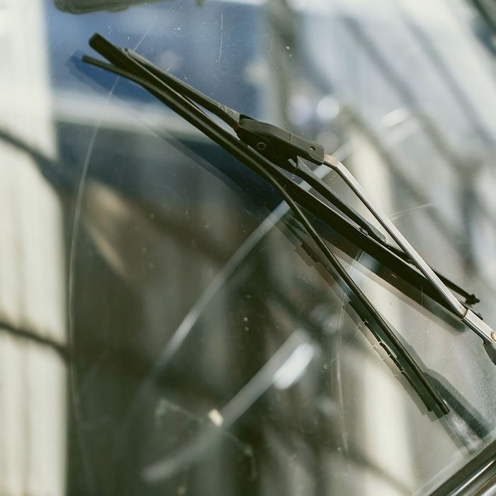An image of wiper blades moving across the windshield surface.