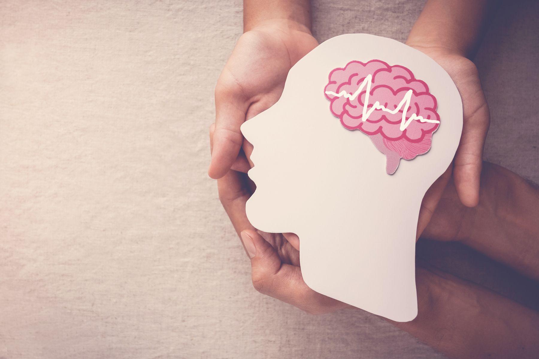 adult-child-hands-holding-encephalography-brain-paper-cutout-epilepsy-alzheimer-awareness-seizure-disorder-mental-health-concept.jpg