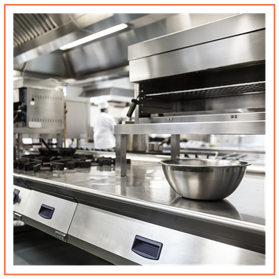 A fully equipped kitchen with stovetops, fryers, and oven