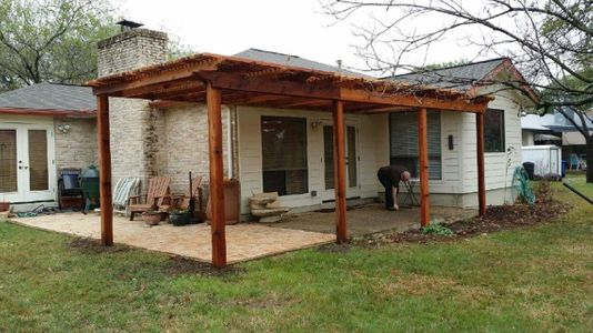 The finished construction of a pergola in a home's backyard - Americraft Siding & Windows