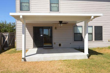 House with backyard patio cover - Americraft Siding & Windows