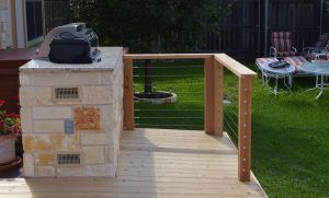 Backyard with deck and built-in grill - Americraft Siding & Windows