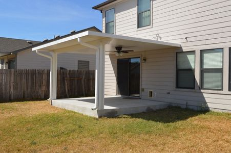 Backyard with concrete patio and solid patio cover - Americraft Siding & Windows