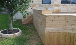 Deck wall with steps and tree - Americraft Siding & Windows