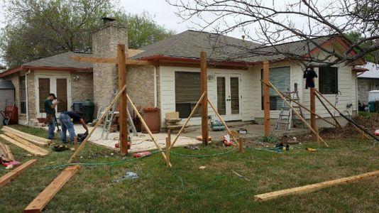The construction of a pergola in progress in a home's backyard - Americraft Siding & Windows