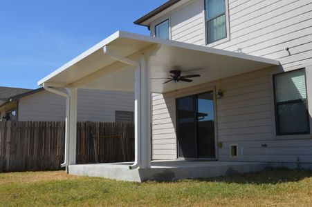 Back patio with cover and ceiling fan - Americraft Siding & Windows