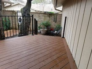 A house with deck and iron railing - Americraft Siding & Windows