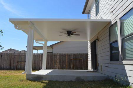 Patio cover with ceiling fan over concrete patio - Americraft Siding & Windows