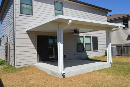 Back of a house with patio cover and gutters - Americraft Siding & Windows