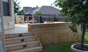 Deck wall with steps and built-in benches - Americraft Siding & Windows