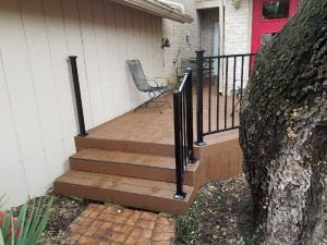 Deck stairs with railing on the back of a house - Americraft Siding & Windows
