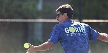A man hitting a tennis ball