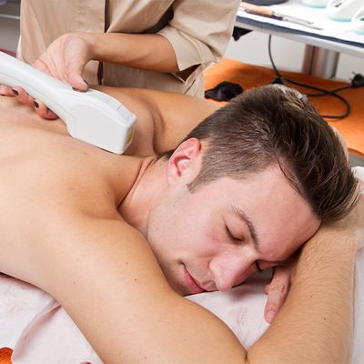 An image of a man getting laser hair removal