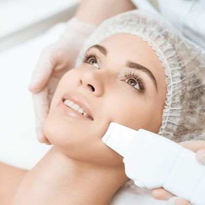 An image of a woman undergoing a laser facial treatment