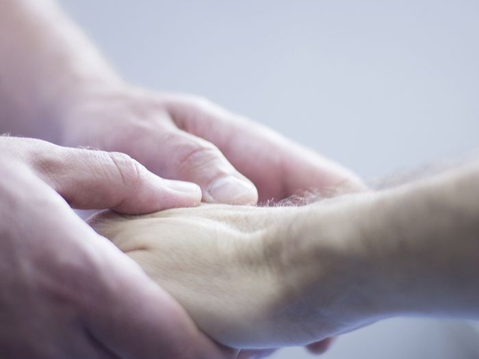 An image of holding hands.