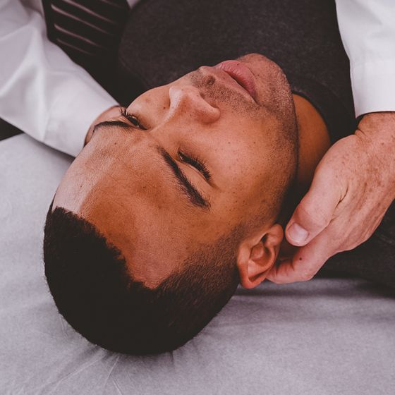 man being examined for concussion