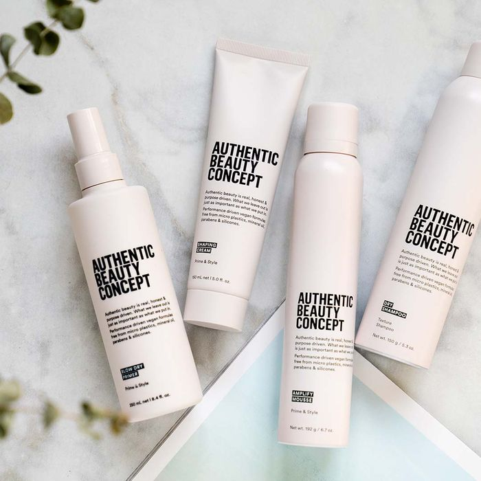 Image of several Authentic Beauty Content products in white bottles.